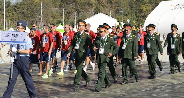 The U.S. Armed Forces Men's Soccer Team and Soldiers from the Republic of Vietnam march together into the opening ceremony of Mungyeong Athlete's Village, Sept. 29, 2015, for the CISM World Games in South Korea.