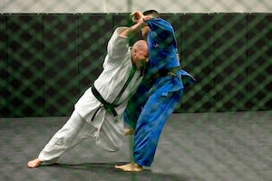 Army Lt. Col. Ben Ring, left and Navy Petty Officer 2nd Class Bobby Yamashita spar during U.S. Armed Forces Judo Team practice at Fort Indiantown Gap, Pa., Sept. 21, 2015. The team is training for the 2015 Military World Games in Mungyeong, South Korea, scheduled for Oct. 2 through Oct. 11. (DoD News photo by EJ Hersom)