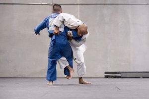 Navy Petty Officer 2nd Class Bobby Yamashita, left and Navy Petty Officer 1st Class Robert Turquest spar during U.S. Armed Forces Judo Team practice at Fort Indiantown Gap, Pa., Sept. 21, 2015. The team is training for the 2015 Military World Games in Mungyeong, South Korea, scheduled for Oct. 2 through Oct. 11. (DoD News photo by EJ Hersom)