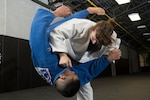 Missouri Army National Guard Capt. Anna Feygina throws Navy Petty Officer 2nd Class Bobby Yamashita during U.S. Armed Forces Tae Kwon Do Team practice at Fort Indiantown Gap, Pa., Sept. 21, 2015. The team is training for the 2015 Military World Games in Mungyeong, South Korea, scheduled for Oct. 2 through Oct. 11. (DoD News photo by EJ Hersom)