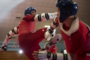 Army 1st Lt. Joshua Fletcher, right, and Air Force Tech Sgt. Quinton Beach spar during U.S. Armed Forces Tae Kwon Do Team practice at Fort Indiantown Gap, Pa., Sept. 21, 2015. The team is training for the 2015 Military World Games in Mungyeong, South Korea, scheduled for Oct. 2 through Oct. 11. (DoD News photo by EJ Hersom)