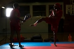 Army National Guard Sgt. Lamonte Kelly, right, kicks a target held by Army Staff Sgt. Ashley Sadlowski during U.S. Armed Forces Tae Kwon Do Team practice at Fort Indiantown Gap, Pa., Sept. 21, 2015. The team is training for the 2015 Military World Games in Mungyeong, South Korea, scheduled for Oct. 2 through Oct. 11. (DoD News photo by EJ Hersom)