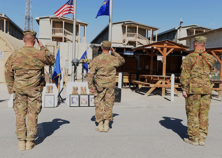 Maj. Met Berisha (left), the 455th Expeditionary Security Forces Squadron commander; Brig. Gen. David Julazadeh (center), the 455th Air Expeditionary Wing commander; and Lt. Col. Mitchell Spillers, the 774th Expeditionary Airlift Squadron commander, salute the memorial of six fallen Airmen during a fallen comrade ceremony Oct. 3, 2015, at Bagram Airfield, Afghanistan. Six Airmen lost their lives when their C-130J Super Hercules crashed shortly after takeoff from Jalalabad Airfield in Afghanistan, Oct. 2, 2015. Capts. Jordan Pierson and Jonathan Golden, Staff Sgt. Ryan Hammond and Senior Airman Quinn Johnson-Harris were pilots and crew members. Airman 1st Class Kcey Ruiz and Senior Airman Nathan Sartain were security forces fly away security team members. (U.S. Air Force photo/Senior Airman Cierra Presentado)