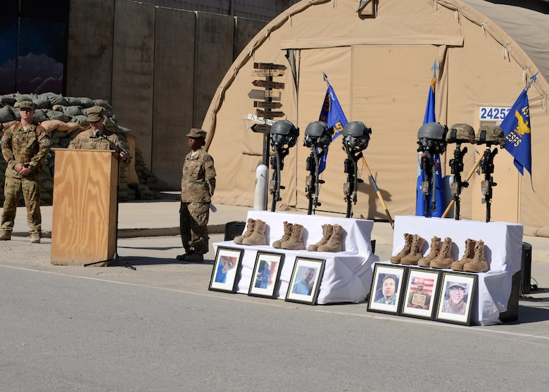 Maj. Met Berisha, 455th Expeditionary Security Forces Squadron commander, shares his condolences for six fallen Airmen during a fallen comrade memorial ceremony Oct. 3, 2015, at Bagram Airfield, Afghanistan. The Airmen lost their lives when their C-130J Super Hercules crashed shortly after takeoff from Jalalabad Airfield in Afghanistan, Oct. 2, 2015. Capts. Jordan Pierson and Jonathan Golden, Staff Sgt. Ryan Hammond and Senior Airman Quinn Johnson-Harris were pilots and crew members. Airman 1st Class Kcey Ruiz and Senior Airman Nathan Sartain were security forces fly away security team members. (U.S. Air Force photo/Senior Airman Cierra Presentado)