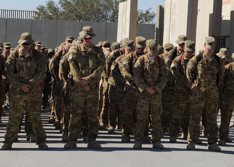 Airmen from the 774th Expeditionary Airlift Squadron gather at a fallen comrade memorial ceremony Oct. 3, 2015, at Bagram Airfield, Afghanistan. Six Airmen lost their lives when their C-130J Super Hercules crashed shortly after takeoff from Jalalabad Airfield in Afghanistan, Oct. 2, 2015. Capts. Jordan Pierson and Jonathan Golden, Staff Sgt. Ryan Hammond and Senior Airman Quinn Johnson-Harris were pilots and crew members. Airman 1st Class Kcey Ruiz and Senior Airman Nathan Sartain were security forces fly away security team members. (U.S. Air Force photo/Senior Airman Cierra Presentado)