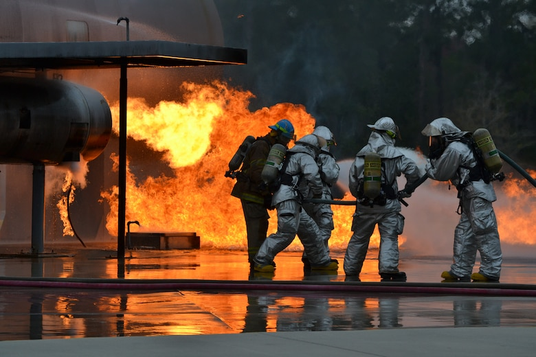Firefighters from the 120th Airlift Wing practice putting out a simulated aircraft engine fire at the Fire Academy of the South. Thirty-eight members of the Montana Air National Guard deployed to Jacksonville, Fla., and integrated with the Florida Air National Guard for two weeks of specialty training in February 2015.  (U.S. Air National Guard photo/Master Sgt. Anthony Barille)