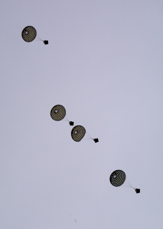 Parachuted training cargo falls to the ground after being dropped from a C-130 Hercules transport aircraft assigned to the 120th Airlift Wing of the Montana Air National Guard Aug. 12, 2015. The aircraft was taking part in an exercise dropping cargo at the Spearhead Drop Zone located west of Toston, Mont. (U.S. Air National Guard photo/Senior Master Sgt. Eric Peterson)