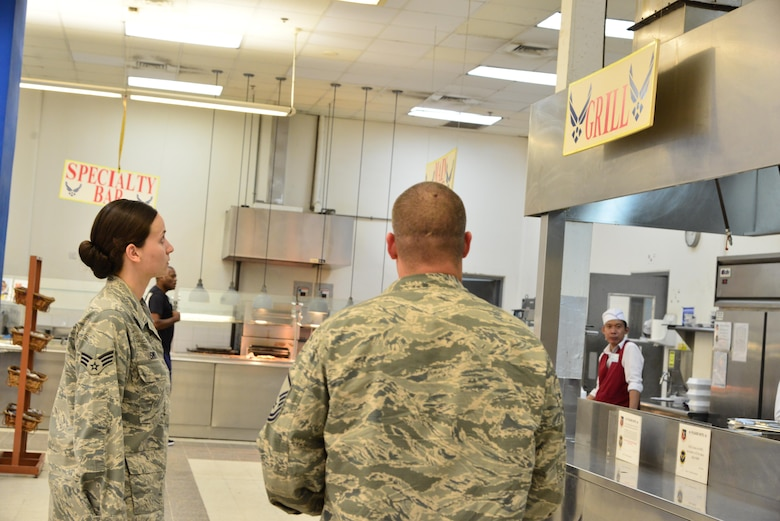 Senior Airman Leah Smith, 379th Expeditionary Medical Operations Support Squadron Bioenvironmental, surveys a dining facility ventilation system that will be tested for its flow rate with Master Sgt. Christopher Lance, 379th Expeditionary Civil Engineer Squadron Fire Department, September 30, 2015 at Al Udeid Air Base, Qatar. (U.S. Air Force photo/Staff Sgt. Alexandre Montes)
