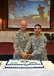 In celebration of the 68th Air Force Birthday, DLA Aviation Commander Brig. Gen. Allan Day and the most junior DLA Aviation Airman in attendance, Staff Sgt Jimmy Pauth, inventory management specialist, Customer Operations Directorate, cut the Air Force birthday cake during a celebration September 21, 2015 at Defense Supply Center Richmond, Virginia.