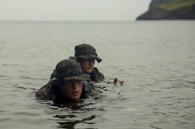 Cpl. Wills Brooks, front, and Lance Cpl. Maksimilian Pavloskiy execute scout swimmer techniques during clandestine landing training at Ternate, Philippines, Oct. 1, 2015. The Marines rehearsed clandestine landings and withdrawals with their Filipino counterparts, which increased their mission readiness during maritime raid operations. This training was in part of Amphibious Landing Exercise 2015, which is an annual, bilateral training exercise conducted by U.S. Marine and Navy Forces with the Armed Forces of the Philippines in order to strengthen our interoperability and working relationships across the range of military operations — from disaster relief, to complex expeditionary operations. Brooks from Nashville, Tenn. is a reconnaissance man with 3rd Reconnaissance Battalion, 3rd Marine Division, III Marine Expeditionary Force. Pavloskiy from Pittsburgh, Pennsylvania, is a reconnaissance man with 3rd Recon Bn, 3rd MarDiv, III MEF.