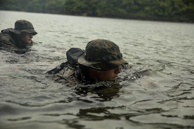Cpl. Wills Brooks, front, and Lance Cpl. Maksimilian Pavloskiy execute scout swimmer techniques during clandestine landing training at Ternate, Philippines, Oct. 1, 2015. The Marines rehearsed clandestine landings and withdrawals with their Filipino counterparts, which increased their mission readiness during maritime raid operations. This training was in part of Amphibious Landing Exercise 2015, which is an annual, bilateral training exercise conducted by U.S. Marine and Navy Forces with the Armed Forces of the Philippines in order to strengthen our interoperability and working relationships across the range of military operations — from disaster relief, to complex expeditionary operations. Brooks from Nashville, Tenn., is a reconnaissance man with 3rd Reconnaissance Battalion, 3rd Marine Division, III Marine Expeditionary Force. Pavloskiy from Pittsburgh, Penn., is a reconnaissance man with 3rd Recon Bn, 3rd MarDiv, III MEF.