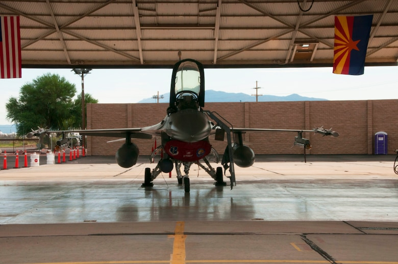 An F-16 from the Aerospace Control Alert Detachment from the 162nd Wing sits at the ready in a hangar at Davis-Monthan Air Force Base in Tucson, Arizona, Sept. 12, 2015. The detachment maintains the ability to quickly scramble in response to airborne threats in the Southwest United States, as well as proactively defend large gatherings and high profile events. (Air National Guard photo by Senior Airman David English)