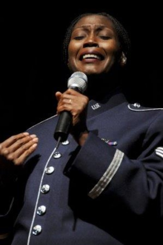 Staff Sgt. Lisa Cimino, a chaplain's assistant and professional vocalist, performs at a 555th Air National Guard Band event in 2010. Sergeant Cimino is a chaplain's assistant with the 161st Air Refueling Wing and she connects with others through singing and encouraging words. (Courtesy photo)