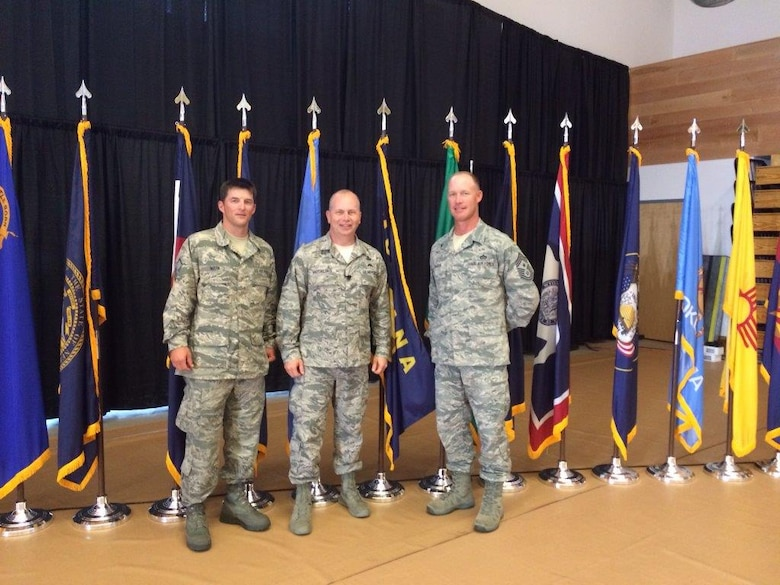 Master Sgt. Jeremy Marn, 120th Airlift Wing crew chief, left, poses for a photo with Command Chief Master Sgt. for the Air National Guard, Chief Master Sgt. James Hotaling, center, and Command Chief Master Sgt. for the Montana Air National Guard, Chief Master Sgt. Tim Zumbrun, at the ANG Enlisted Leadership Symposium held at Camp Dawson, West Virginia, Aug. 26-28. (Courtesy photo)
