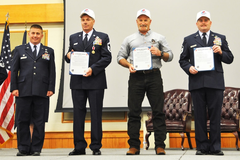 219th RED HORSE Commander Lt. Col. Rusty Vaira, left, presented Order of the White Hat certificates and hats to Senior Master Sgt. Joseph Carter, Senior Master Sgt. Mark Lund and Master Sgt. Robert Brewer  during their retirement ceremonies May 2, 2015. (U.S. Air National Guard photo/1st Lt. Robin Allen)