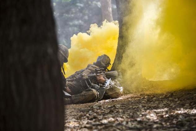 Republic of Korea Marine Lance Cpl. Jun Shin, left, provides buddy aid to a U.S. Marine during a gas attack drill as part of Korean Marine Exchange Program 15-12 at Gunha-Rhi, Republic of Korea, Sept. 17, 2015. The U.S. and ROK Marines practiced quickly putting on their gas mask and carrying the simulated wounded to safety. KMEP 15-12 is an exercise in a series of continuous bilateral training exercises that enhances the ROK and U.S. alliance, promotes stability on the Korean Peninsula and strengthens ROK and U.S. military capabilities and interoperability. Shin is with 2nd Company, 11th Battalion, 1st Regiment, 2nd Marine Division, ROK Headquarters Marine Corps. The U.S. Marines are with Fox Company, 2nd Battalion, 3rd Marine Regiment, currently assigned to 4th Marine Regiment, 3rd Marine Division, III Marine Expeditionary Force under the unit deployment program.