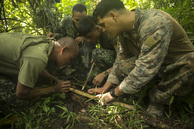 Philippine and U.S. Marines work together to start a fire using bamboo during jungle survival training at Ternate, Philippines, Sept. 29, as part of Amphibious Landing Exercise 2015. The Marines learned basic jungle survival skills, such as building a fire, finding sources of fresh water and catching food. Phiblex 2015 is an annual, bilateral training exercise conducted by U.S. Marine and Navy Forces with the Armed Forces of the Philippines in order to strengthen our interoperability and working relationships across a wide range of military operations — from disaster relief to complex expeditionary operations.