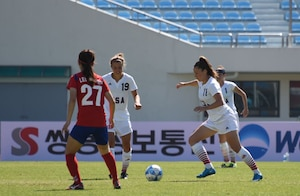 #19 Leah M. Bratt #1 Michelle L. Moeller #11 USA Soccer team member Jennifer M. Grijalva, No. 11, moves forward with the ball during the game against South Korea in Gimcheon, Oct. 5. Teammates Leah Bratt (19) and Michelle Muller (1) follow while Lee, Young Ju (27) of the ROK team marks the play.