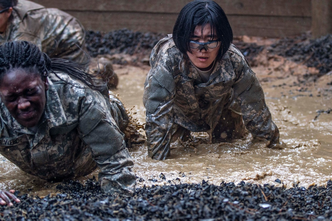 Army Pvt. Tanica Marco in her second week of basic combat training makes her way through the final water obstacle at the Fit to Win endurance course on Fort Jackson, S.C., Oct. 1, 2015. Marco is assigned to Company B, 3rd Battalion, 34th Infantry Regiment. U.S. Army photo by Sgt. 1st Class Brian Hamilton