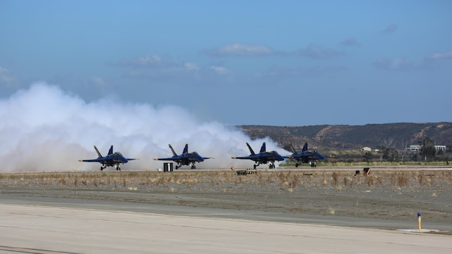 U.S. Navy Blue Angels begins their takeoff during the 2015 MCAS Miramar Air Show at Marine Corps Air Station Miramar, California, Oct. 2. Sixteen pilots volunteer to fly in the formation of F/A-18 Hornets to show audiences around the world the capabilities of the armed forces' aircraft.