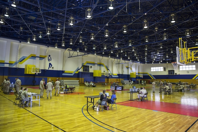 A variety of departments gathered together to conduct a noncombatant evacuation operation exercise inside the IronWorks Gymnasium at Marine Corps Air Station Iwakuni, Japan, Sept. 30, 2015. A NEO can be triggered by anything from a military threat to a natural disaster. This operation is conducted to evacuate noncombatants, nonessential military personnel, selected host-nation citizens, and third country nationals, who are in danger, to a safe location.