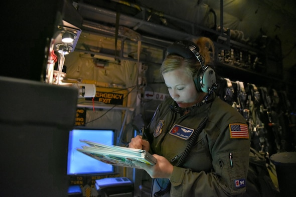 Tech. Sgt. Jenna Daniel, a 53rd Weather Reconnaissance Squadron loadmaster, logs information on a dropsonde to be dropped in the eyewall of Hurricane Joaquin during a mission into the storm Oct. 2, 2015. Hurricane Joaquin has downgraded to a Category 1 storm. (U.S. Air Force Photo/Staff Sgt. Nicholas Monteloene)