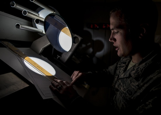 Staff Sgt. Erin O'Connell, a solar analyst with Detachment 2, 2nd Weather Squadron, creates a sunspot drawing from a projected image of the sun at the Holloman Solar Observatory on Holloman Air Force Base, N.M., Sept. 24, 2015. Sunspots are temporary phenomena on the visible surface of the sun that appear visibly as dark spots compared to surrounding regions. The solar analysts closely monitor this information in order to safeguard and protect important assets in both civilian and Defense Department agencies. (U.S. Air Force photo/Senior Airman Aaron Montoya)