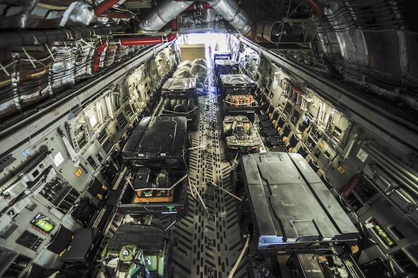 Equipment in support of U.S. Air Forces Central Command personnel recovery mission arrive on a C-17 Globemaster III assigned to Charleston Air Force Base, S.C., Sept. 28, 2015, at Diyarbakir Air Base, Turkey. The deployment of assets and personnel will enable the USAFCENT with recovery of coalition partners should they need assistance in Syria or Iraq. (U.S. Air Force photo/Airman 1st Class Cory W. Bush)