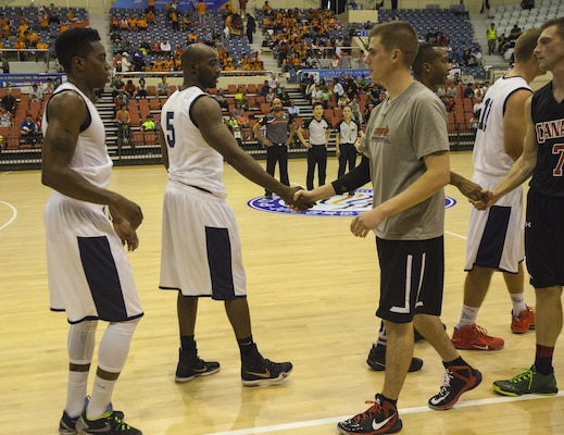 U.S. Men's Basketball Team shakes hands with Canadian Men's Basketball team after winning the first game. The CISM World Games provides the opportunity for the athletes of over 100 different nations to come together and enjoy friendship through sports. The sixth annual CISM World Games are being held aboard Mungyeong, South Korea, Sept. 30 - Oct. 11.
