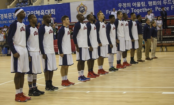 The U.S. Men's Basketball Team stands at attention for the national anthem during the U.S. Vs. Canada Men's Basketball game. The CISM World Games provides the opportunity for the athletes of over 100 different nations to come together and enjoy friendship through sports. The sixth annual CISM World Games are being held aboard Mungyeong, South Korea, Sept. 30 - Oct. 11.