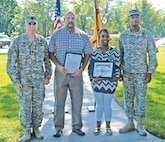 Employee of the Month nominees – Brittney Toombs (second from right), Directorate of Family, Morale, Welfare and Recreation, and John G. Meredith (second from left), Directorate of Plans, Training, Mobilization and Security, stand with Fort Riley Garrison Commander Col. Andrew Cole, Jr. (far right) and Command Sgt. Maj. Jason Schmidt (far left) after receiving their awards at the Garrison and Partner Awards Ceremony at Ware Parade Field Sept. 10.