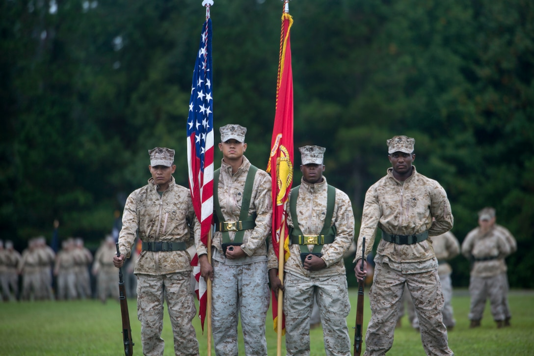 Marines post the colors during the Combat Logistics Battalion 8's reactivation ceremony at Camp Lejeune, N.C., Oct. 1, 2015. The unit's reactivation allows 2nd MLG to provide direct support to all of 2nd Marine Division's infantry units, and it is scheduled to take over the logistics command element of Special Purpose Marine Air Ground Task Force-Africa in 2017. (U.S. Marine Corps photo by Cpl. Fatmeh Saad/Released)