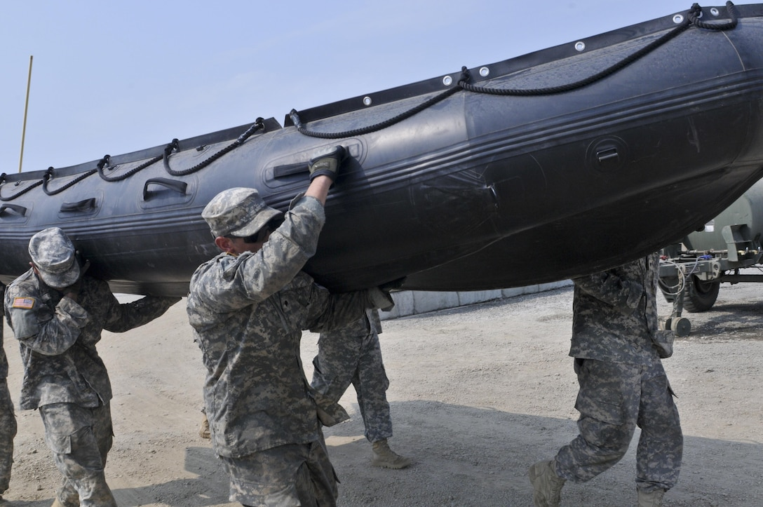 U.S. Army Reserve Soldiers with the 391st Engineer Company out of Boise, Idaho, compete in Sapper Stakes 2015 in a timed Zodiac boat carry at Fort Chaffee, Ark., Aug. 31. (U.S. Army photo by Staff Sgt. Debralee Best)