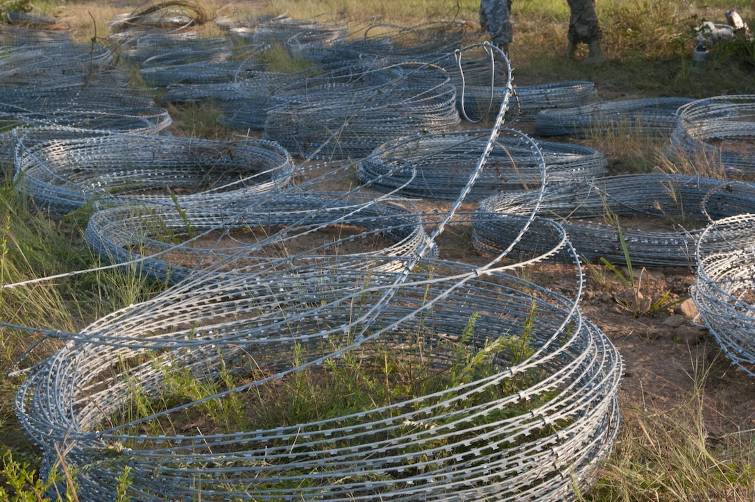 U.S. Army Reserve and National Guard Sapper Stakes 2015 competitors emplaced a hasty frat fence using concertina wire and pickets as part of the competition at Fort Chaffee, Ark., Sept. 1. (U.S. Army photo by Staff Sgt. Debralee Best)