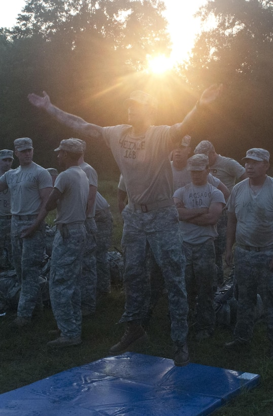 U.S. Army Reserve Sgt. Matthew Heinle, combat engineer, 455th Engineer Company out of Hayden Lake, Idaho, brings his hands together to clap during a burpee during Sapper Stakes 2015 at Fort Chaffee, Ark., Aug. 30. Teams were required to complete a combined total of 500 burpees during the nonstandard Army physical fitness test, the first event of the competition. (U.S. Army photo by Staff Sgt. Debralee Best)