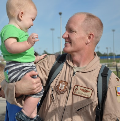 Maj. Chase Crosby, 18th Air Refueling Squadron pilot, greets his son after returning from a deployment to Southwest Asia, Oct. 4, 2014, at McConnell Air Force Base, Kan. Crosby returned along with 19 other members of the 931st Air Refueling Group.(U.S. Air Force photo by Tech. Sgt. Abigail Klein)