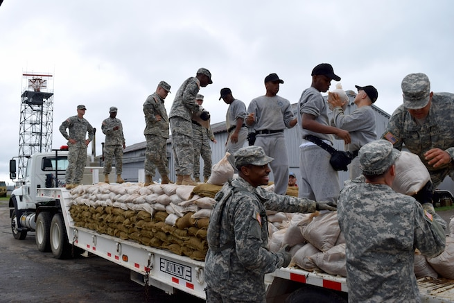 Georgia Army National Guardsmen fill sandbags in anticipation of possible flooding in Augusta, Georgia, Oct. 4, 2015. Georgia Army National Guard photo by Capt. William Carraway