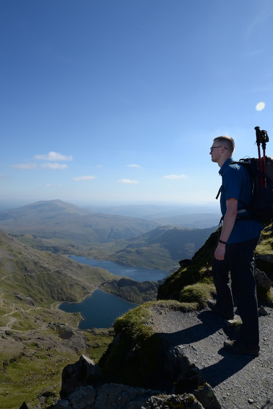 U.S. Air Force Senior Airman Fletcher Swanson, 352d Special Operations Support Squadron, intelligence analysis, reflects on his journey to the top of Mt. Snowdon, the third peak faced on a Preservation of the Force and Family Task Force event, Sept. 27, 2015. The exercise was designed to assist Airmen and their spouses, both co-located and geographically separated, in overcoming challenges and understanding the impact of their decisions. Throughout the journey, couples were given questions for reflection and journals to document their experiences. (U.S. Air Force photo by 1st Lt. Chris Sullivan/Released)