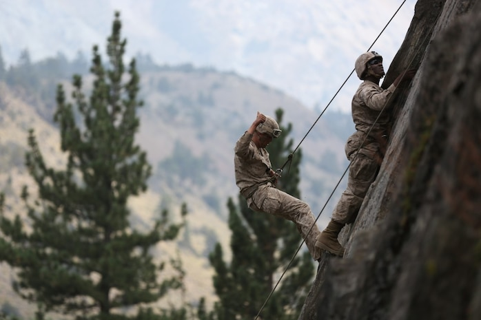 Lance Cpl. John Whitlock, an intelligence analyst assigned to Headquarters Company, Headquarters Battalion, 1st Marine Division, gives a thumbs-up after regaining his footing while rappelling during phase two of Mountain Warfare Training Exercise 5-15 aboard Marine Corps Mountain Warfare Training Center Bridgeport, Calif., Sept. 10, 2015. The training covered maneuvering throughout mountainous terrain features by rope climbing and rappelling as well as surviving in the rugged environment. (U.S. Marine Corps photo by Cpl. Will Perkins/Released)