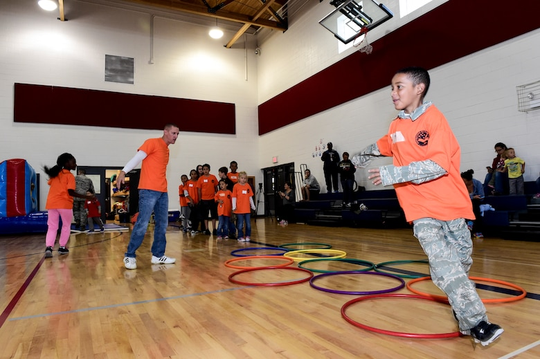 Participants of Operation Future Forces perform a variety of drills to complete their basic training Oct. 3, 2015, at the youth center on Buckley Air Force Base, Colo. OFF is an annual Team Buckley activity where service members' children are given a taste of military life, including a swear-in-ceremony, basic training and a mock deployment. (U.S. Air Force photo by Senior Airman Phillip Houk/Released)