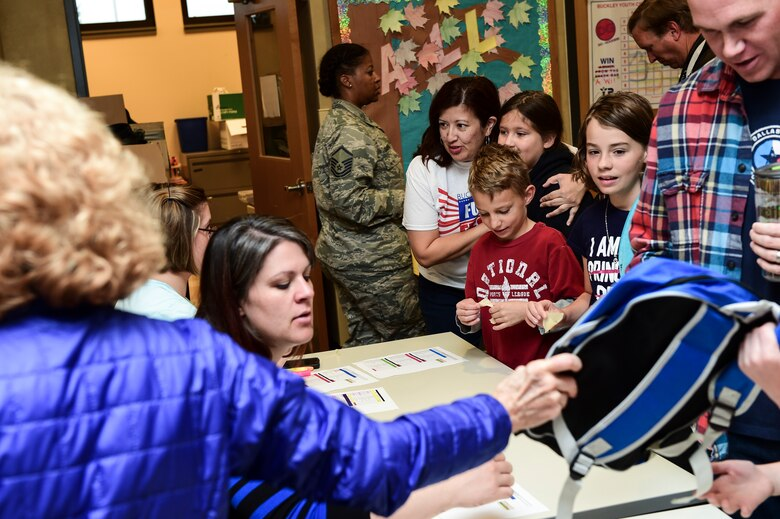 Parents of Team Buckley children register for Operation Future Forces Oct. 3, 2015, at the youth center on Buckley Air Force Base, Colo. OFF is an annual Team Buckley activity where service members' children are given a taste of military life, including a swear-in-ceremony, basic training and a mock deployment. (U.S. Air Force photo by Senior Airman Phillip Houk/Released)