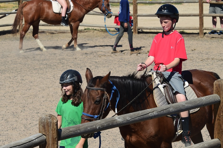 A child from Buckley Air Force Base rides a horse around a ring Sept. 26, 2015, at Urban Farm in Stapleton, Colo. Urban Farm hosted Buckley families, providing them with a tour of the farm as well as an opportunity to interact with the animals. (U.S. Air Force photo by Airman 1st Class Luke W. Nowakowski/Released)