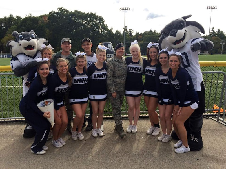 Members from the 157th Air refueling wing pose with University of New Hampshire cheerleaders and mascots at Boulder Field in Durham, N.H., Oct 3, 2015. The members were there to promote the NHANG and get people interested in joining. (N.H. Air National Guard photo by Airman Ashlyn J. Correia/RELEASED)