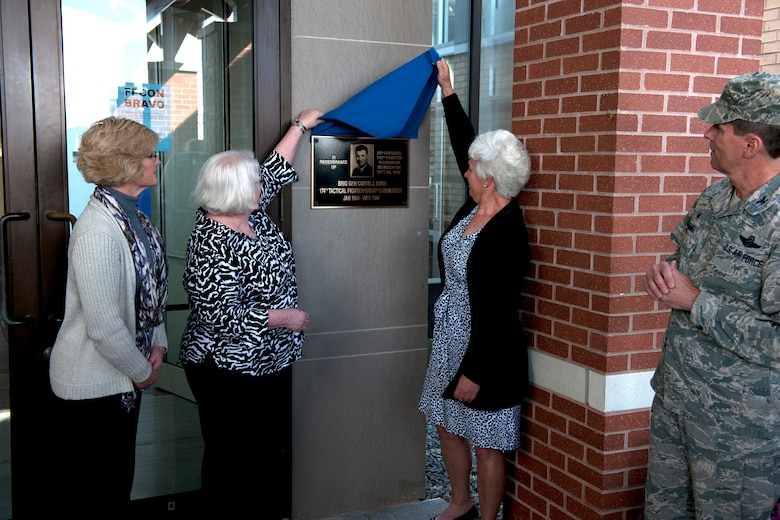 Ms. Sheila Austin, Ms. Laurie Irwin and Chief Master Sergeant (retired) Lisa Damon unveil the plaque in front of the 174th Attack Wing Headquarters building. The headquarters building was dedicated to their father the late Brigadier General Curtis J. Irwin in a ceremony held October 4, 2015. (New York Air National Guard photo by Senior Airman Duane Morgan/Released)