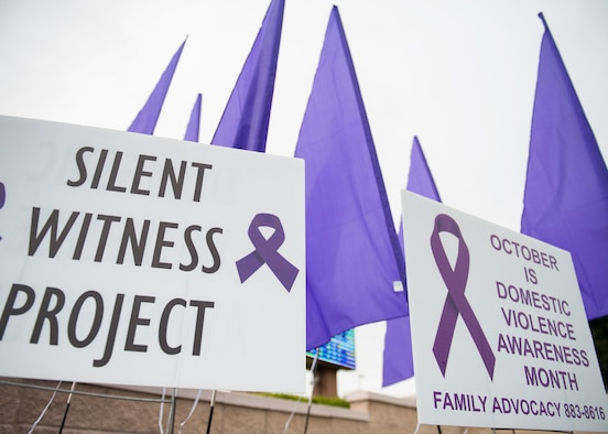 """October is Domestic Violence Awareness Month. The """"purple flyers"""" at the base gates and at the 7th Special Forces Group compound are Eglin's version of the Silent Witness Project. The project honors those who suffered as a result of domestic violence. The SWP was created by women who wanted to speak out about domestic violence. (U.S. Air Force photo/Ilka Cole)"""