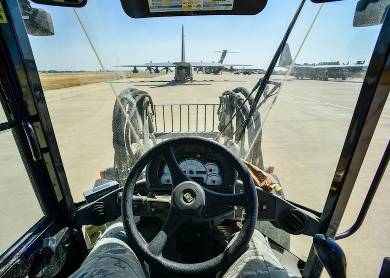 Airman 1st Class Christopher McDade, 435th Contingency Response Squadron air transportation journeyman, stands by to unload cargo off an HC-130J Combat King II, Sept. 28, 2015, at Diyarbakir Air Base, Turkey. Airmen from the 435th Contingency Response Group received more than 680 tons of equipment for base operations in support of U.S. Air Forces Central Command personnel recovery mission for Operation Inherent Resolve. (U.S. Air Force photo by Airman 1st Class Cory W. Bush/Released)