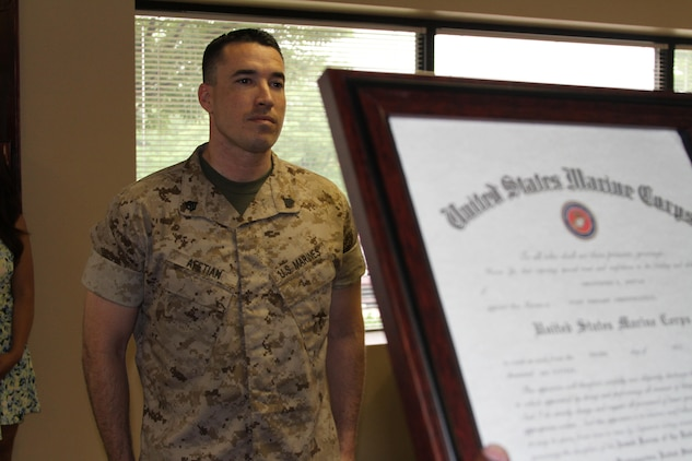 U.S. Marine Corps Staff Sgt. Christopher B. Afetian, from Las Vegas, Nevada, stands at the position of attention while his meritorious promotion warrant is read July 2, 2015, at Recruiting Station Frederick in Frederick, Maryland. The board consisted of a Marine Corps physical fitness test and job performance evaluation. (U.S. Marine Corps photo by Sgt. Anthony J. Kirby/Released)