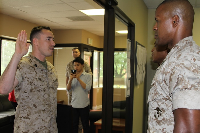 U.S. Marine Corps Staff Sgt. Christopher B. Afetian, from Las Vegas, Nevada, recites the oath of enlistment during his meritorious promotion ceremony July 2, 2015, at Recruiting Station Frederick in Frederick, Maryland. The board consisted of a Marine Corps physical fitness test and job performance evaluation. (U.S. Marine Corps photo by Sgt. Anthony J. Kirby/Released)