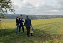 Col. Harry Benham, U.S. Air Forces in Europe-Air Forces Africa operations and plans chief, speaks with the owners of the land Sept. 25, 2015, in Dietingen, Germany, where 2nd Lt. Priesley Cooper Jr.'s P-51 D Mustang was shot down. Cooper was killed in action during a strafing run in World War II. The town of Dietingen buried him and 70 years later held a ceremony to honor him. (U.S. Air Force photo/Staff Sgt. Armando A. Schwier-Morales)