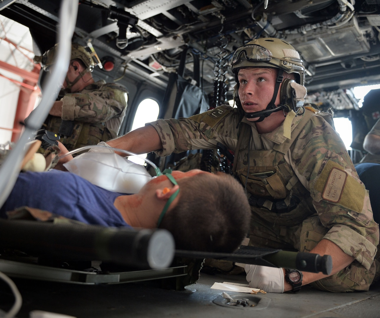 Airman Samual Prescott, a pararescue jumper assigned to the New York Air National Guard's 103rd Rescue Squadron, an element of the 106th Rescue Wing, monitors a patient during a training exercise conducted at F.S. Gabreski Air National Guard Base at Westhampton Beach, New York, on Aug. 25, 2015. The drills was conducted to help evaluate a casualty monitoring system being developed as part of the Air Force BATMAN program, which aims to put useful, wearable technology in the hands of Air Force war fighters.